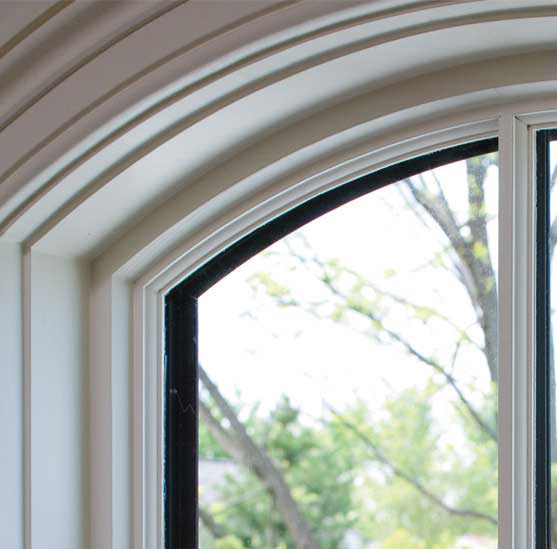 Consider the architecture of your home when choosing a coordinating window material.